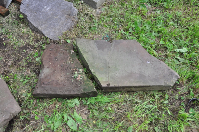 Remaining fragments of Samuel Berrian headstone--the top portion is missing