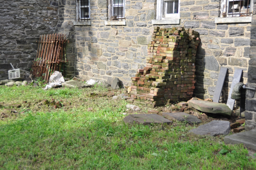 Headstones among debris by Van Cortlandt House Museum