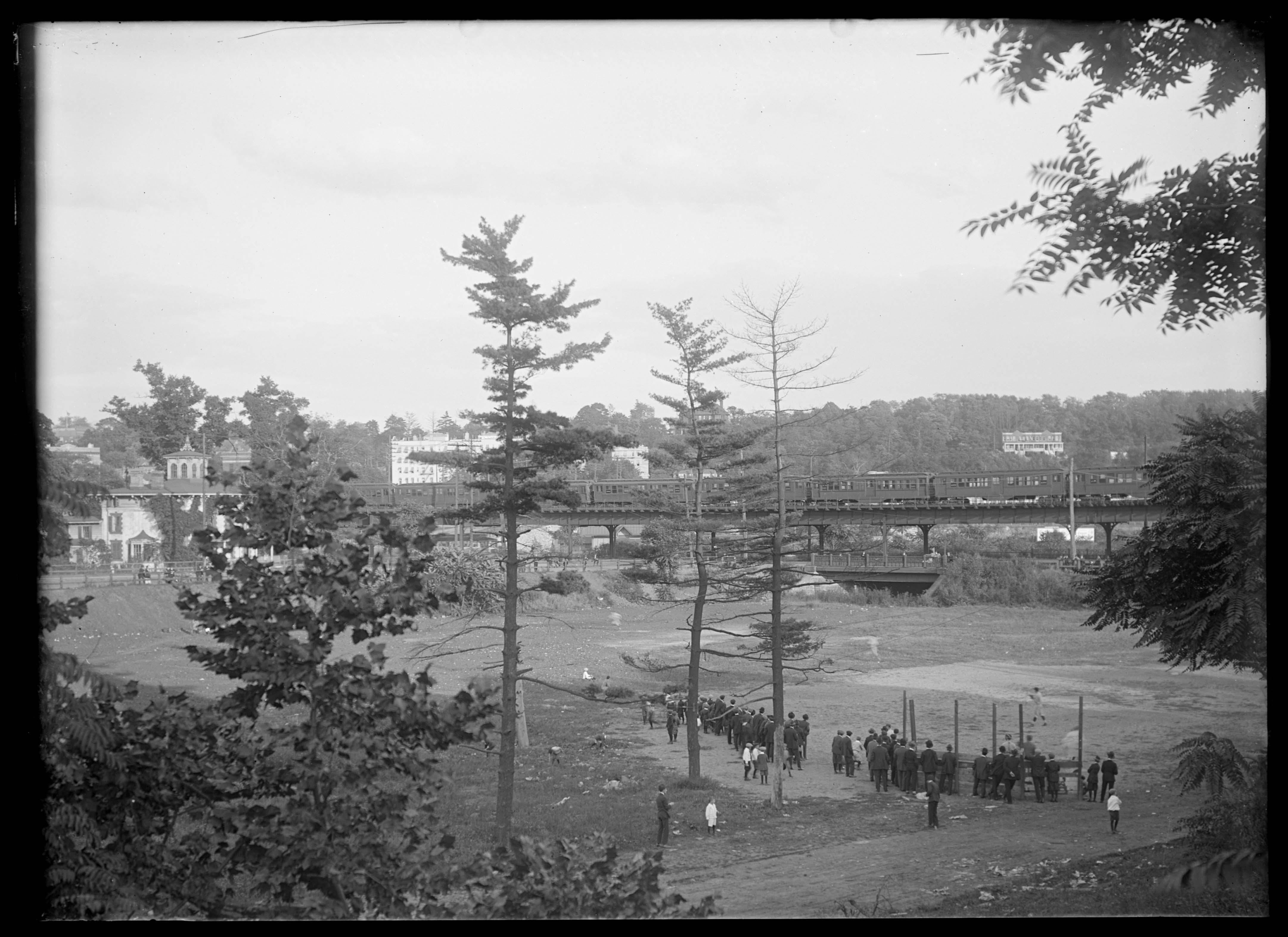 View of Marble Hill Avenue, with a baseball diamond below and elevated train tracks, Bronx, New York City, 1916.