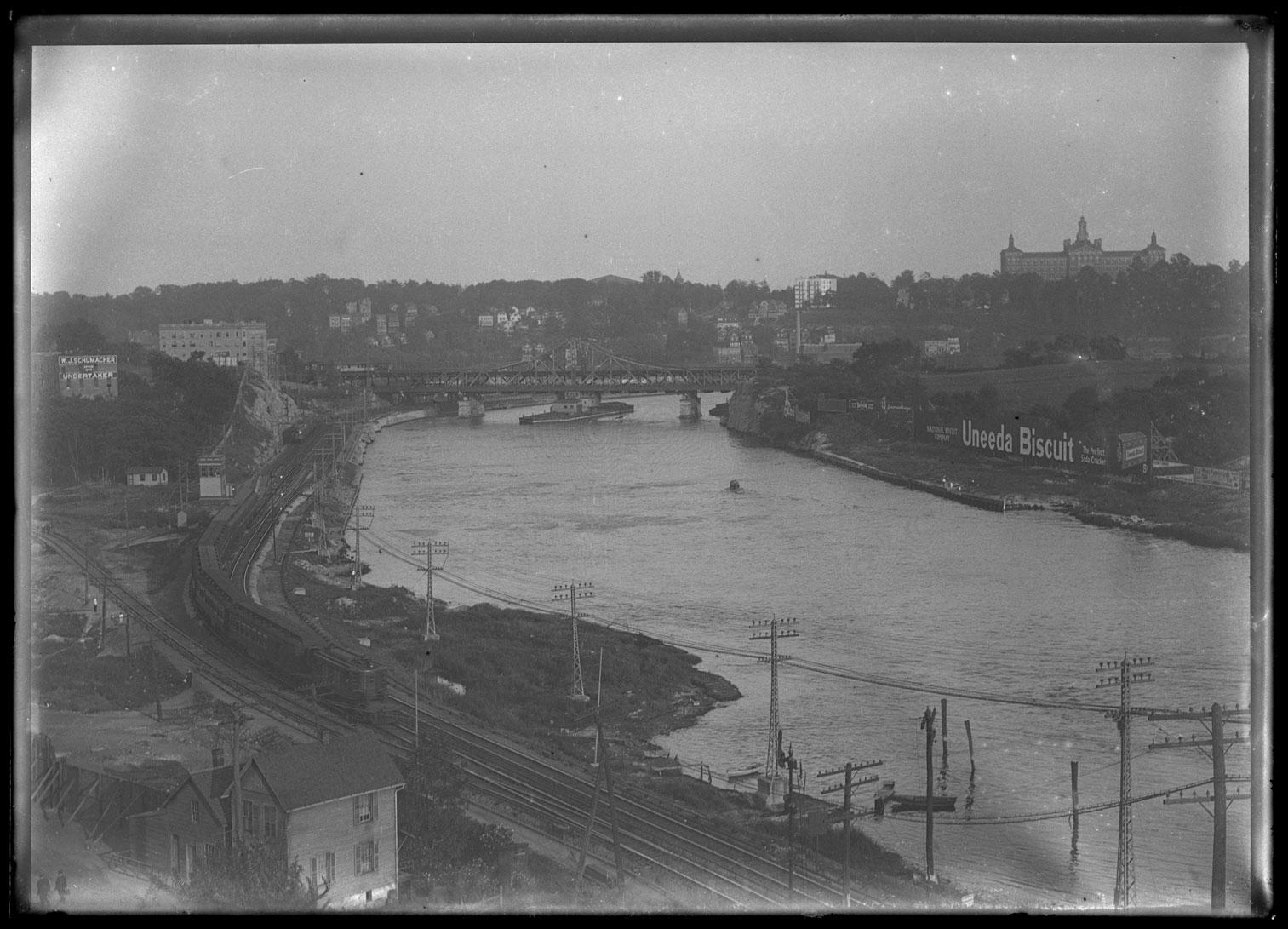 Unidentified express train on track along the Harlem River, New York City, Labor Day, September 4, 1916.