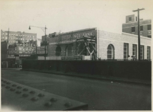 Looking west on W. 231st toward B'way.  Northside Savings Bank under construction.  Gregory Peck and Ava Gardener grace the marquee of the Dale Theater in the background, ca. 1951.